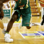 Basketball player spraining his ankle