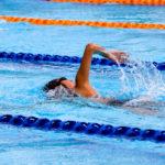 Person swimming in lane