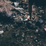 A person traversing rough terrain - foot strength blog featured image