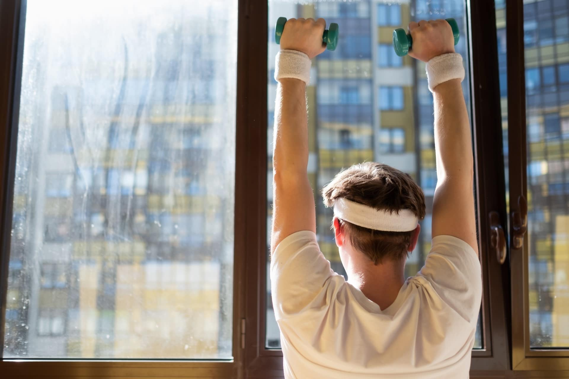 Man Exercising at Home | Does Exercise Boost Immune System? Blog Featured Image.