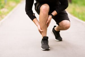 Building back following an injury | Blog Featured Image showing a calf injured runner