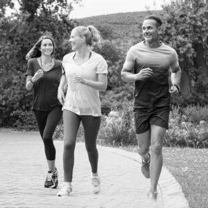 Black and white image of trio running