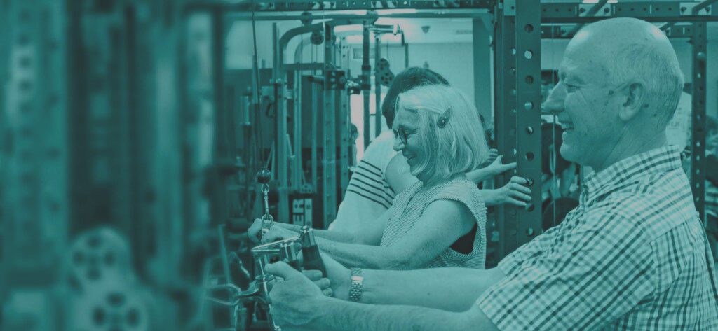 Image of two elderly couple doing a gym exercise
