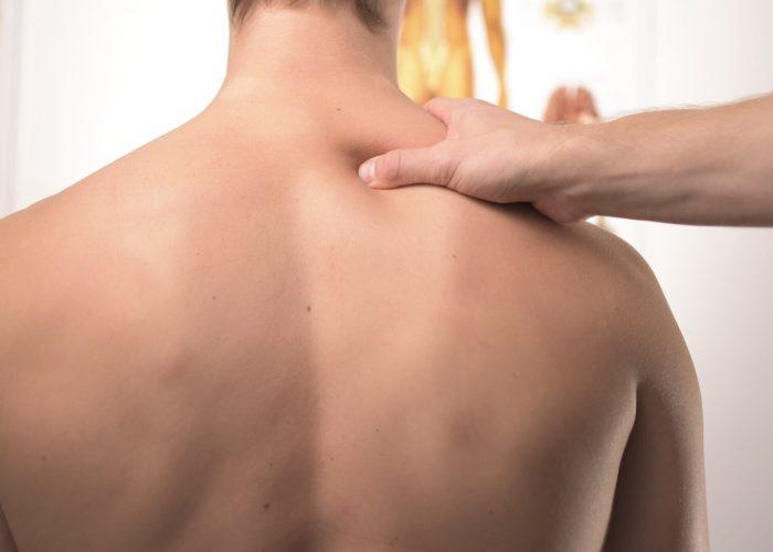 Image of person having shoulder massaged