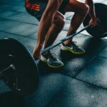 Benefits of exercise during adolescence guy holding weights