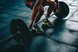 Photo of person leaning down and holding weights