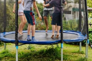 Why exercise is important in adolescence image of kids on trampoline