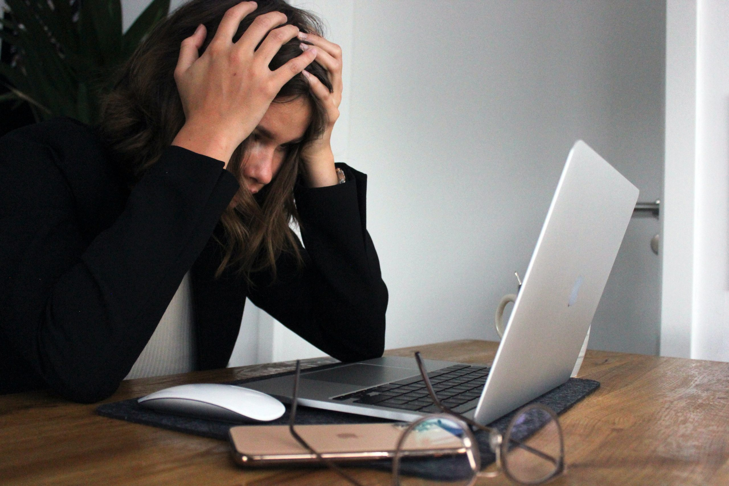 Lady looking at the laptop screen with a concern face | Pivotal Motion