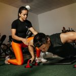 Trainer helping a guy to do push ups   Pivotal Motion