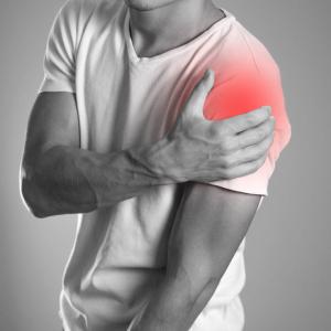 Guy holding his shoulder - Labrum tear   Pivotal Motion